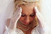 Close-up Portrait Of Beautiful Bride Frown On The Troubles And Pain. White Background