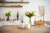 Summer Kitchen Interior In Rustic Style. Bright Kitchen With A Wooden Table. Spring Flowers And Brea poster