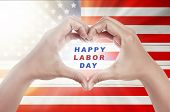 Human Hands In Heart Shape With Happy Labor Day Text Over American Flag Background. Labor Day Concep poster