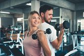 Portrait Of Couple Love In Fitness Training With Dumbbell Equipment., Young Couple Caucasian Are Wor poster