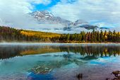 Fabulous reflection. Rocky Mountains, Canada. The Patricia Lake is reflected the Pyramid Mountains. poster