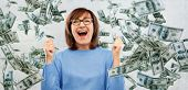 success, jackpot and finances people concept - happy laughing senior woman in glasses celebrating tr poster