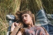 Beautiful Hippie Girl Lying On The Grass poster