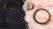 Top View Of Silver Salt Cellar, Raw Natural Pink Halite Mineral And Grained Himalayan Salt On Dark B poster
