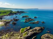 Vivid Emerald-green Water At Ballintoy Harbour Along The Causeway Coast In County Antrim. Rugged Coa poster