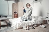 Woman After Breakup Drinking Alcohol And Eating In Bedroom poster