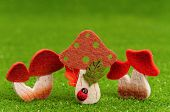 pic of shroom  - Artificial small mushrooms on artificial green grass - JPG