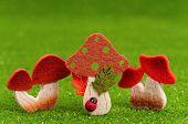 stock photo of shroom  - Artificial small mushrooms on artificial green grass - JPG