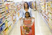picture of grocery-shopping  - Mother with young daughter shopping at the grocery store - JPG