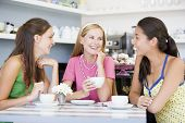 foto of hair integrations  - Three young woman sitting at a table and drinking tea - JPG