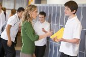 picture of hair integrations  - Female teacher reprimanding a male student - JPG