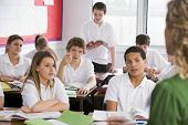 image of hair integrations  - Secondary school student reading out loud in classroom - JPG