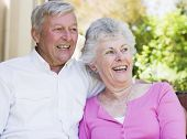 foto of senior-citizen  - Senior couple sitting outdoors - JPG