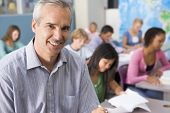 pic of hair integrations  - Students studying in geography class with teacher - JPG