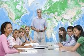 stock photo of hair integrations  - Students answering questions in geography class - JPG