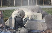 image of sandblasting  - This sandblasting worker is engraving the lettering into the large stone monument - JPG