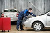 image of internal combustion  - motor mechanic diagnosing automobile car engine before maintenance at repair service station - JPG