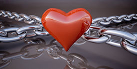 pic of glans  - Shiny red heart and a chain on a dark gray background - JPG