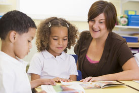 image of school child  - Students in class with teacher reading  - JPG