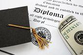 stock photo of tassels  - graduation cap and money on a diploma - JPG