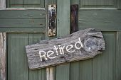 foto of retirement  - Old retired sign on green double door - JPG