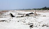 stock photo of sundarbans  - Wrecked fishing boat after a cyclone hit the Sundarbans of Bangladesh - JPG