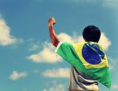 Excited man holding a brazil flag