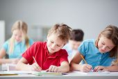 image of pretty-boy  - Portrait of two diligent pupils drawing at lesson - JPG