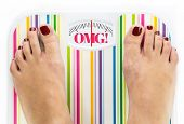 stock photo of skinny fat  - Feet on bathroom scale with word  - JPG