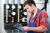 stock photo of hot water  - Technician servicing the gas boiler for hot water and heating  - JPG