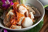 stock photo of green papaya salad  - Traditional dish of freshly prepared Thai food - JPG