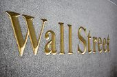 picture of nyse  - Wall Street golden sign curved in stone
