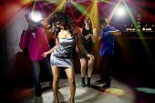 stock photo of rave  - cool people dancing in a nightclub or bar lounge - JPG