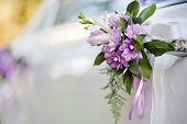 stock photo of luxury cars  - White luxury wedding car decorated with flowers. ** Note: Shallow depth of field - JPG
