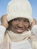picture of racial discrimination  - Girl wearing a white cap and smiling under the winter sun - JPG