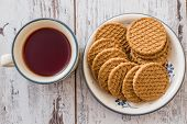 pic of biscuits  - Tea and biscuits in ceramic kitchenware on wooden white background - JPG