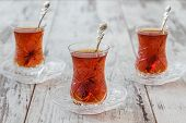 picture of traditional  - Turkish tea served in traditional glasses on white wooden background - JPG