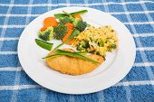 foto of poblano  - A breaded chicken breast with broccoli and carrots cheesy rice garnished with green poblano chili peppers - JPG