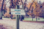 pic of opposites  - Rustic wooden sign in an autumn park with the words Before  - JPG