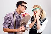 stock photo of she-male  - Portrait of happy nerdy couple - JPG