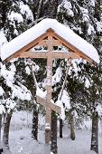 pic of baptism  - Orthodox antique handmade wooden cross in winter forest on baptism - JPG