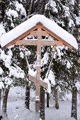 stock photo of baptism  - Orthodox antique handmade wooden cross in winter forest on baptism - JPG