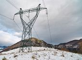 stock photo of power transmission lines  - Landscape with an electricity power transmission tower over the mountain - JPG
