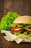 foto of hamburger  - Big hamburger and fresh lettuce close up - JPG