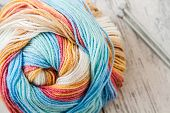 picture of knitting  - Colorful woolen knitting yarn on white wooden background - JPG