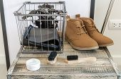 image of shoe-box  - brown leather shoes and brush on wooden box - JPG