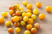 picture of plum tomato  - fresh picked ripe organic colorful mini tomatoes on rustic wooden background - JPG