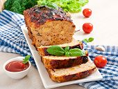 pic of meatloaf  - Homemade ground meatloaf with ketchup and basil - JPG