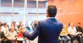 stock photo of entrepreneurship  - Speaker at Business Conference with Public Presentations - JPG