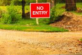 stock photo of restriction  - Not Enter sign outdoor on fence to restricted area of property - JPG